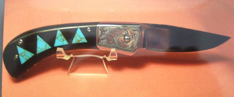 """Scale release Auto. 3"""" blade of 440-C, mirror polished, ebony handles, turquoise inlays, fileworked and engraved bolsters."""
